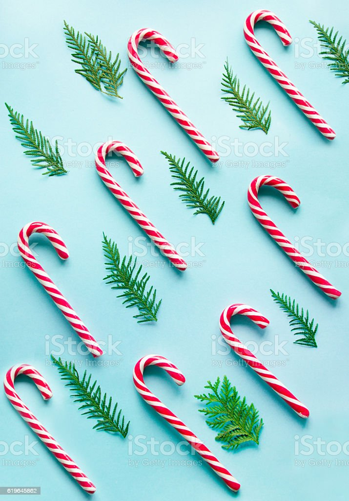 Christmas candy cane on blue background.  Flat lay. Top view. stock photo