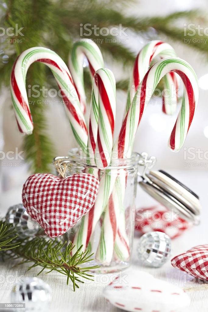 Christmas Candy canes displayed in a glass jar decoration stock photo