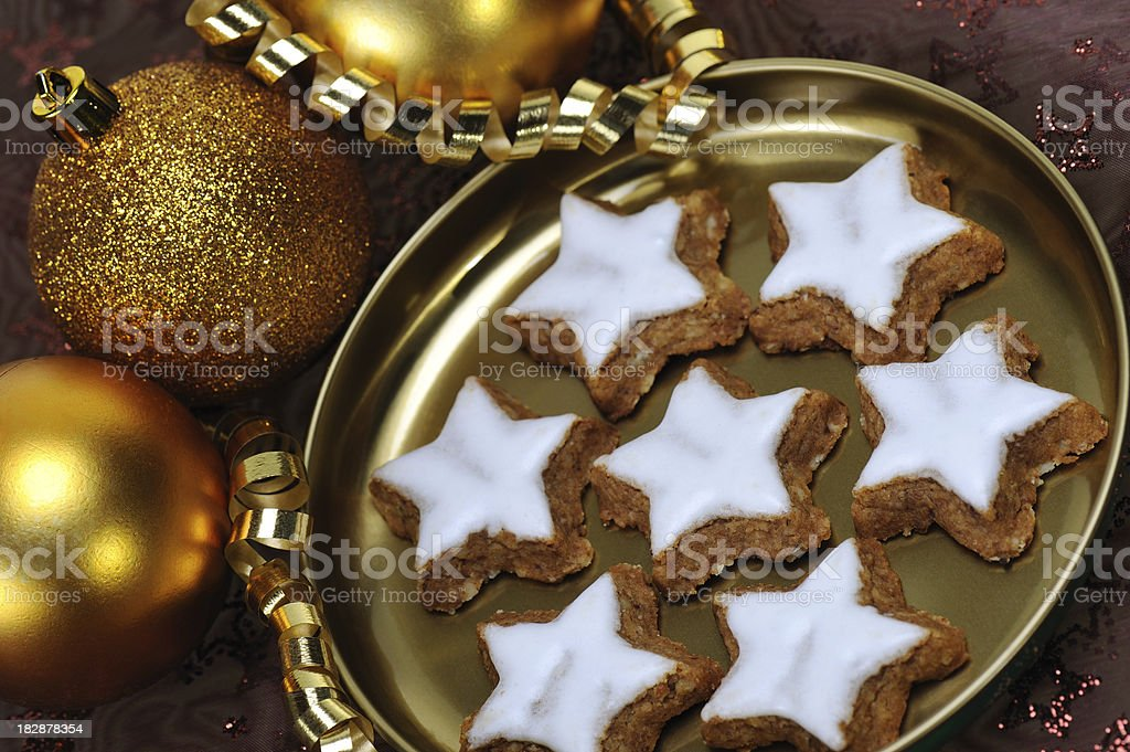 Christmas Candy Cinnamon Stars with Golden Baubles stock photo