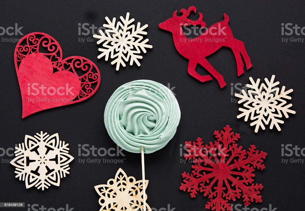 Christmas candy with decor on black. Top view and copyspace. stock photo