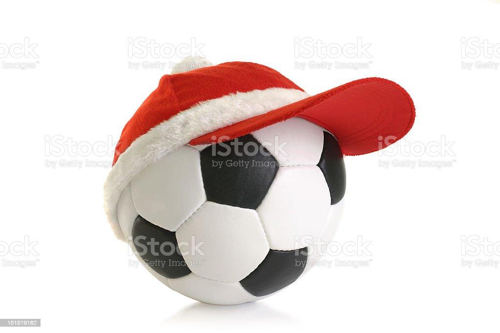 Christmas cap on soccer ball stock photo