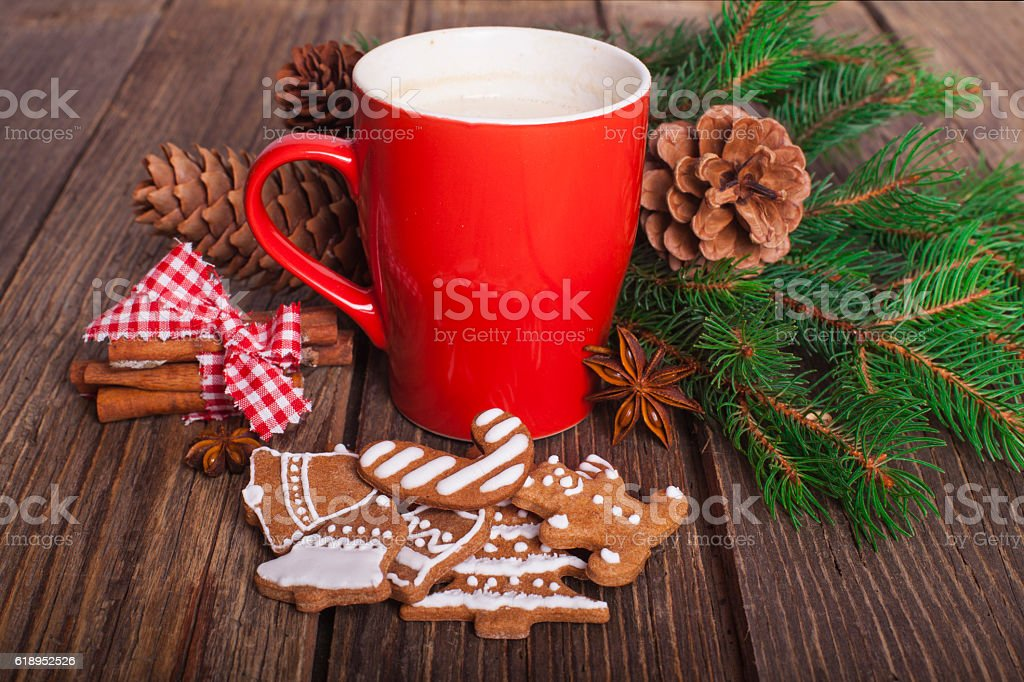 Christmas cappuccino and gingerbread cookies infront Christmas tree stock photo