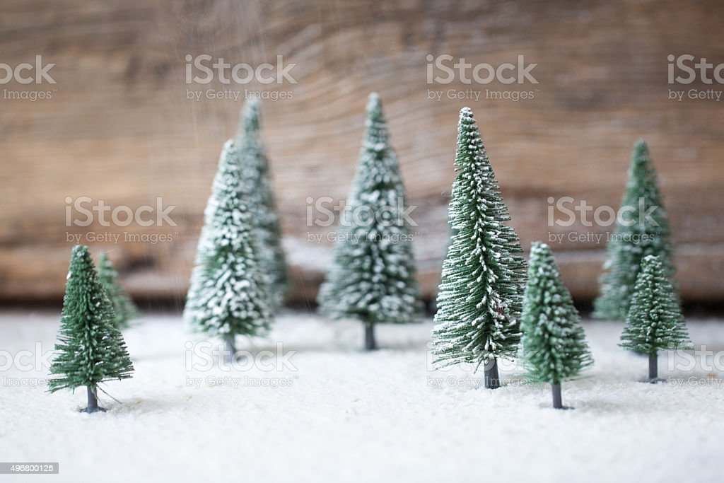 Christmas card - a miniature Christmas tree in the snow stock photo