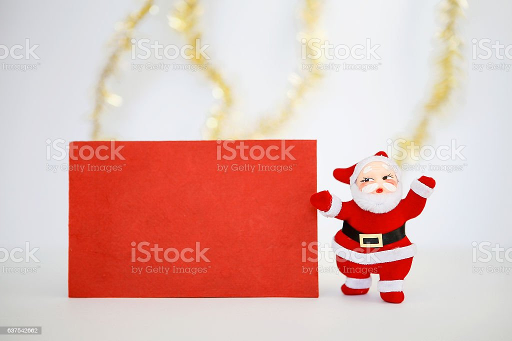 Christmas card and Santa clause doll stock photo