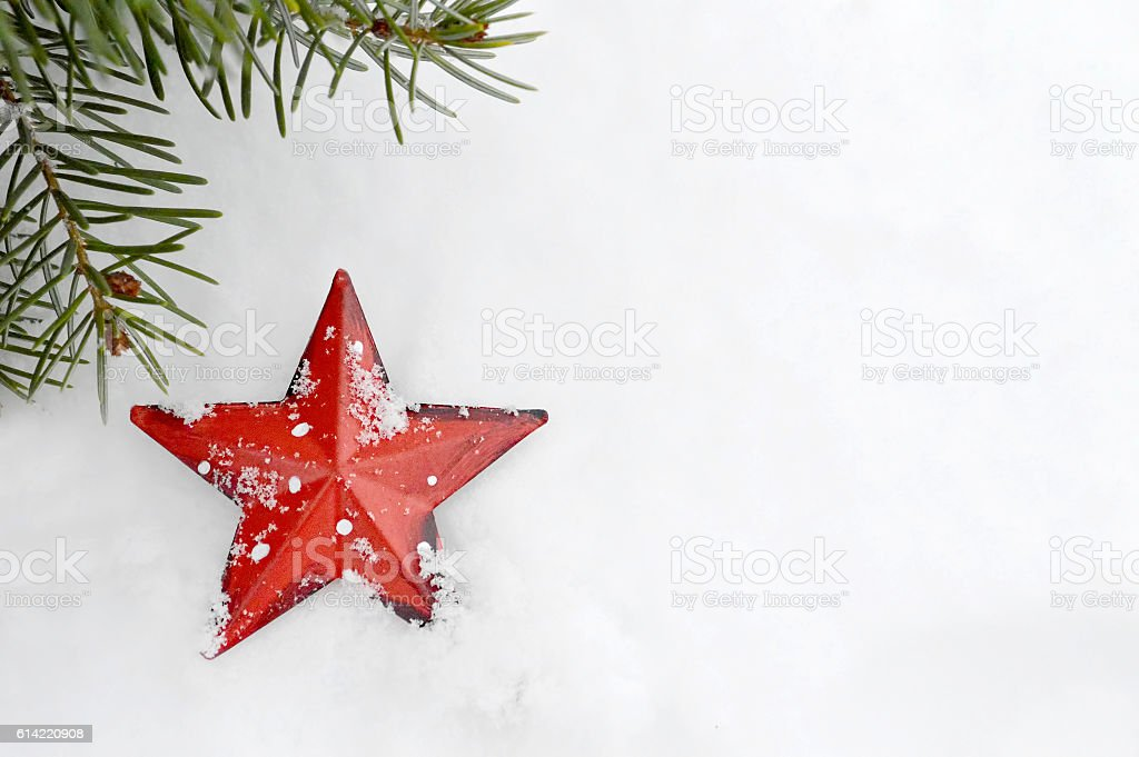 Christmas card: Christmas star ornament in the snow stock photo