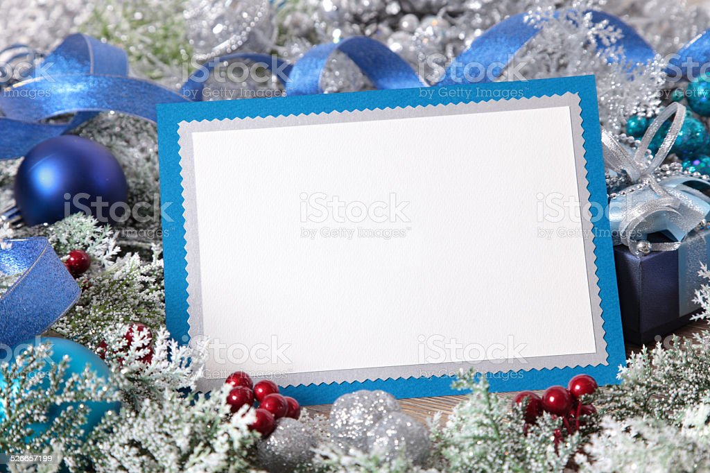 Christmas card or invitation with blue envelope surrounded by decorations stock photo