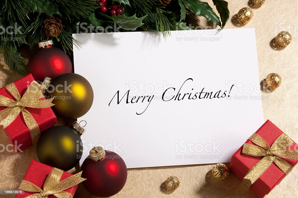 Christmas card under tree with small presents royalty-free stock photo