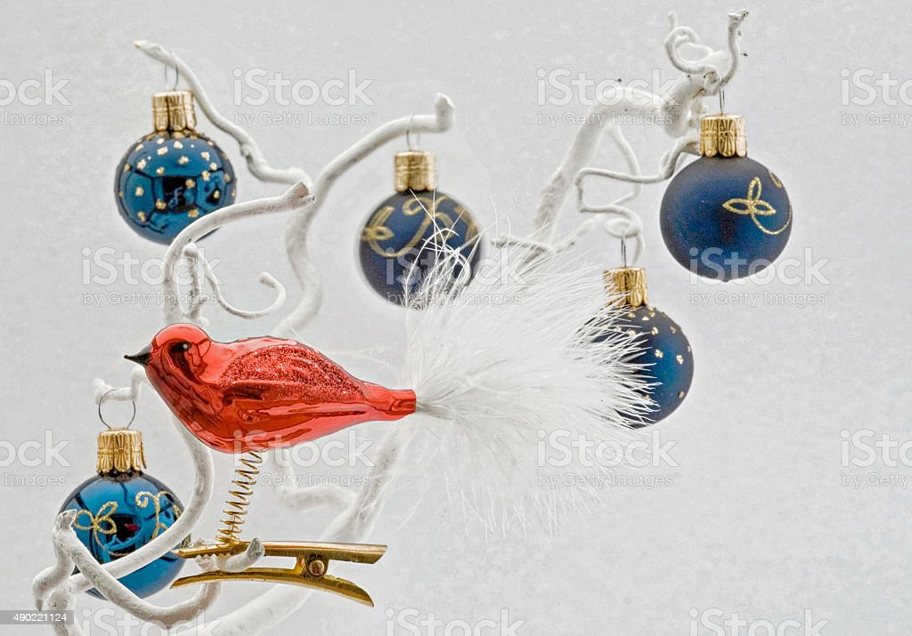 Christmas card with blue balls and red bird stock photo