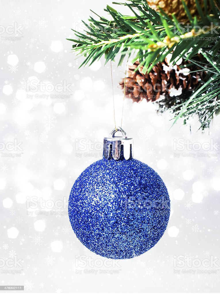 Christmas card with blue hanging ball and pine branch royalty-free stock photo