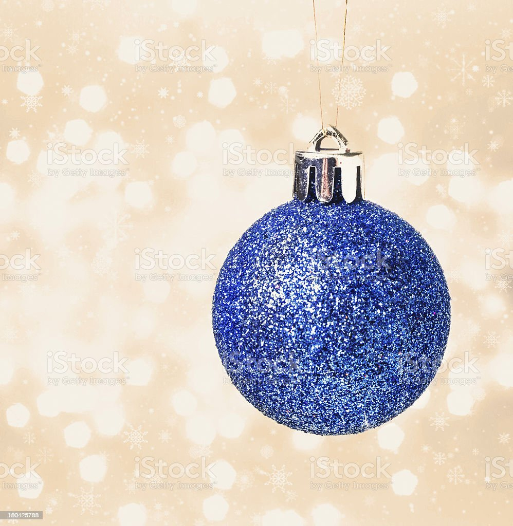 Christmas card with blue hanging ball  on Defocused gold Christm royalty-free stock photo