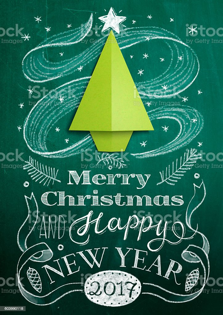 Christmas card with chalkboard and origami tree stock photo