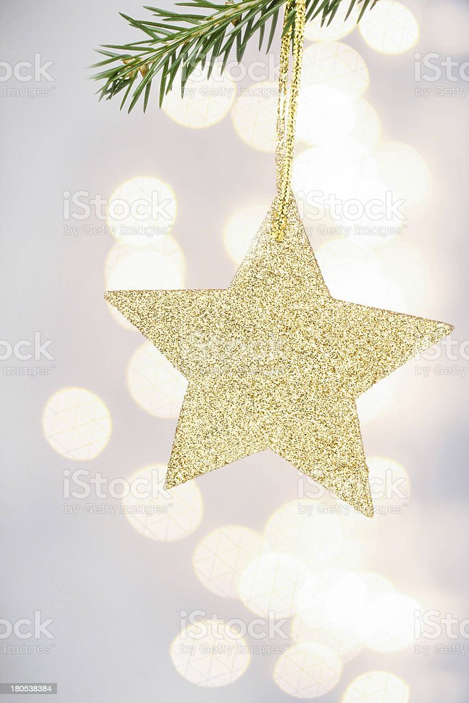 Christmas card with golden star and pine branch on Defocused royalty-free stock photo