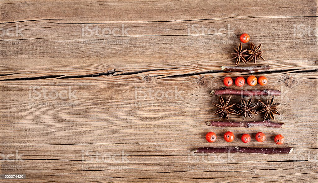 Christmas card with natural decorations on wooden background stock photo