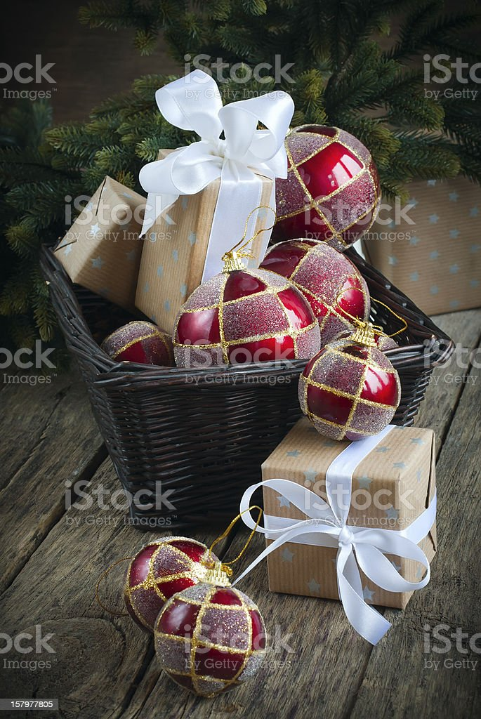Christmas Card with Red Balls and Boxes in a Basket royalty-free stock photo
