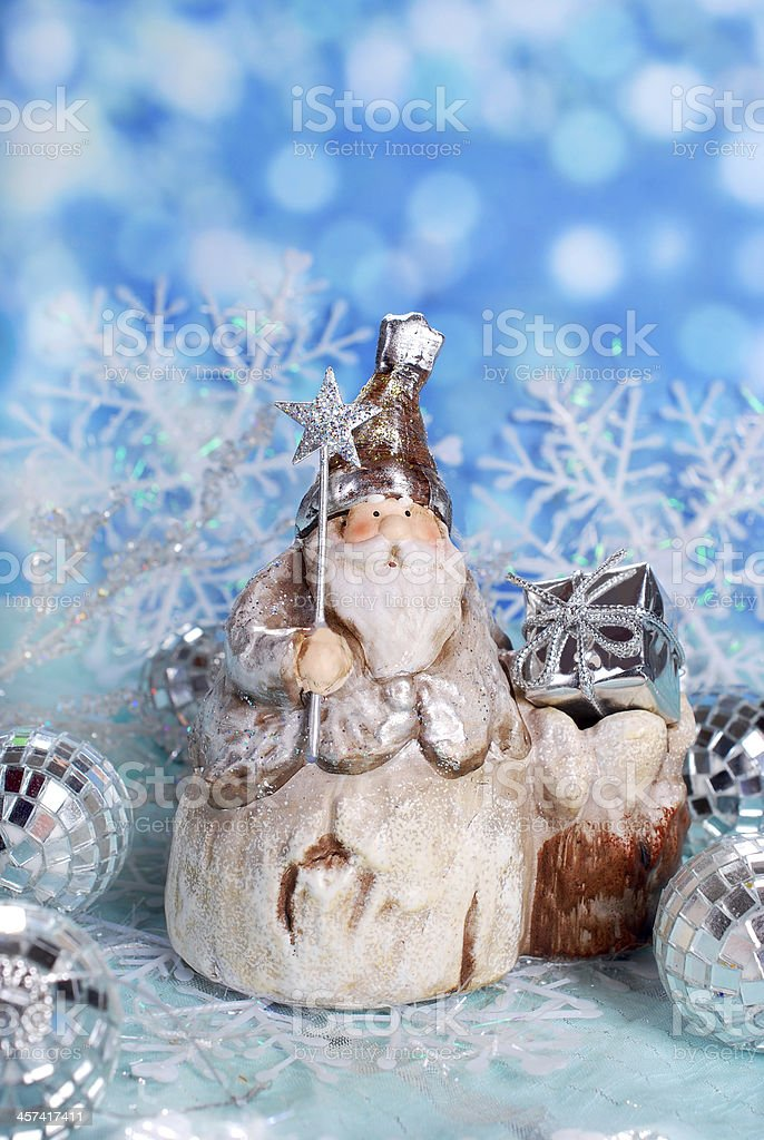 christmas card with vintage santa figurine on winter blue background royalty-free stock photo
