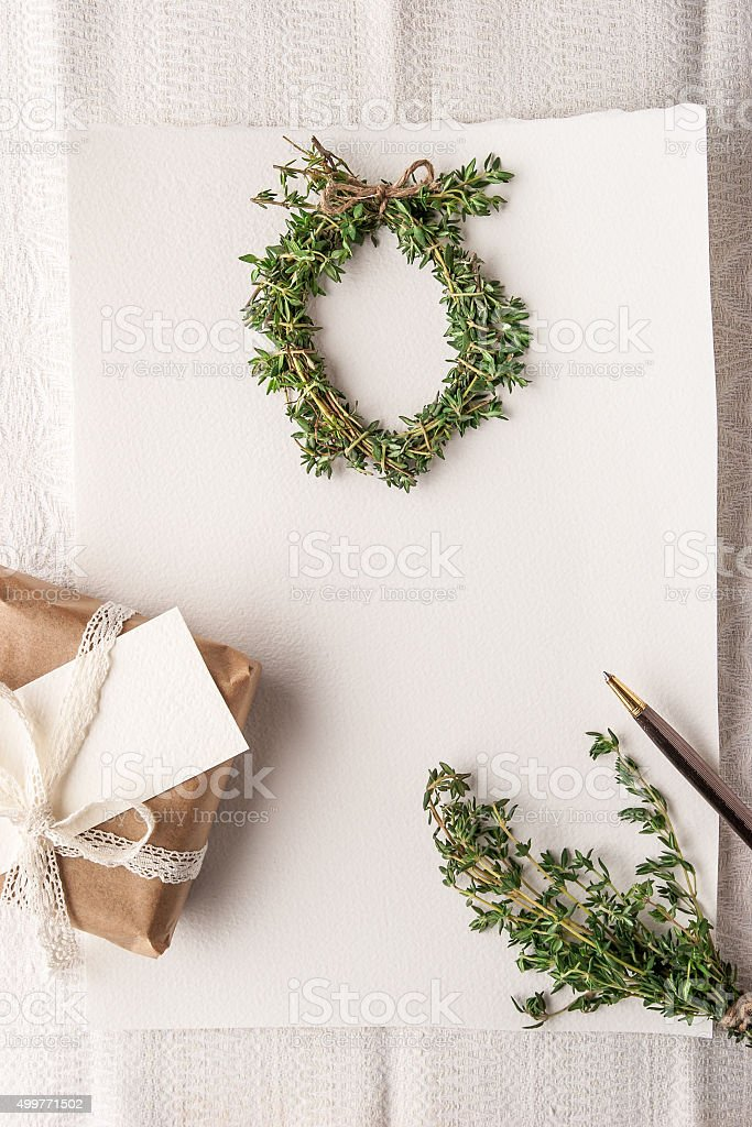 Christmas card with  wreath of rosemary and present vertical stock photo