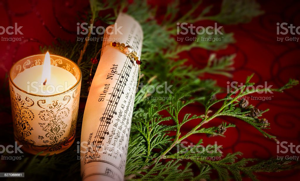 Christmas Carol music with candle and pine stock photo