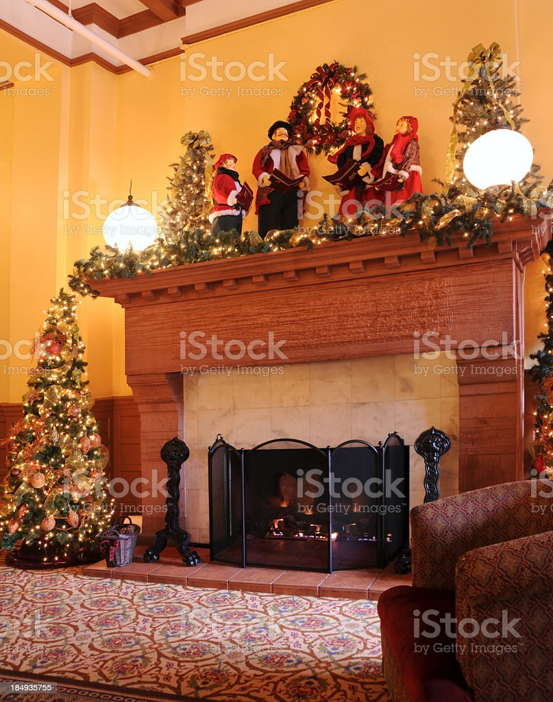 Christmas Carolers on Historic Fireplace royalty-free stock photo