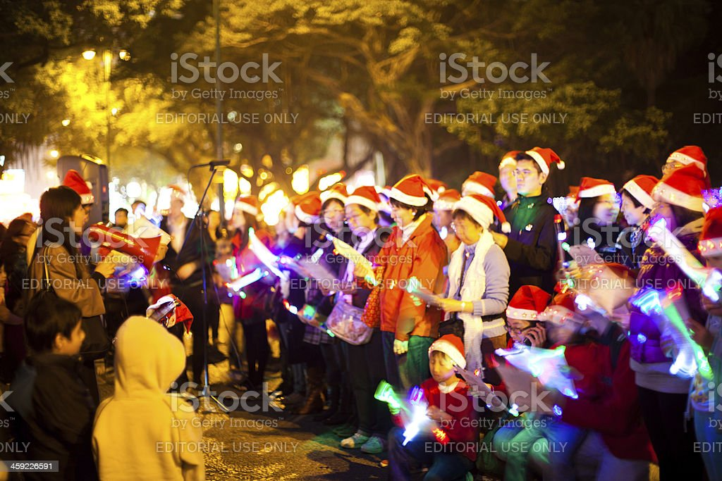 Christmas carolers stock photo