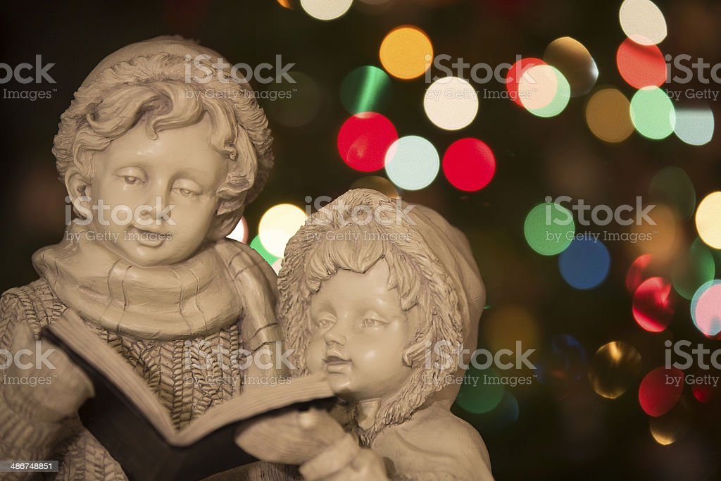Christmas Carolers with Christmas Lights - Horizontal stock photo