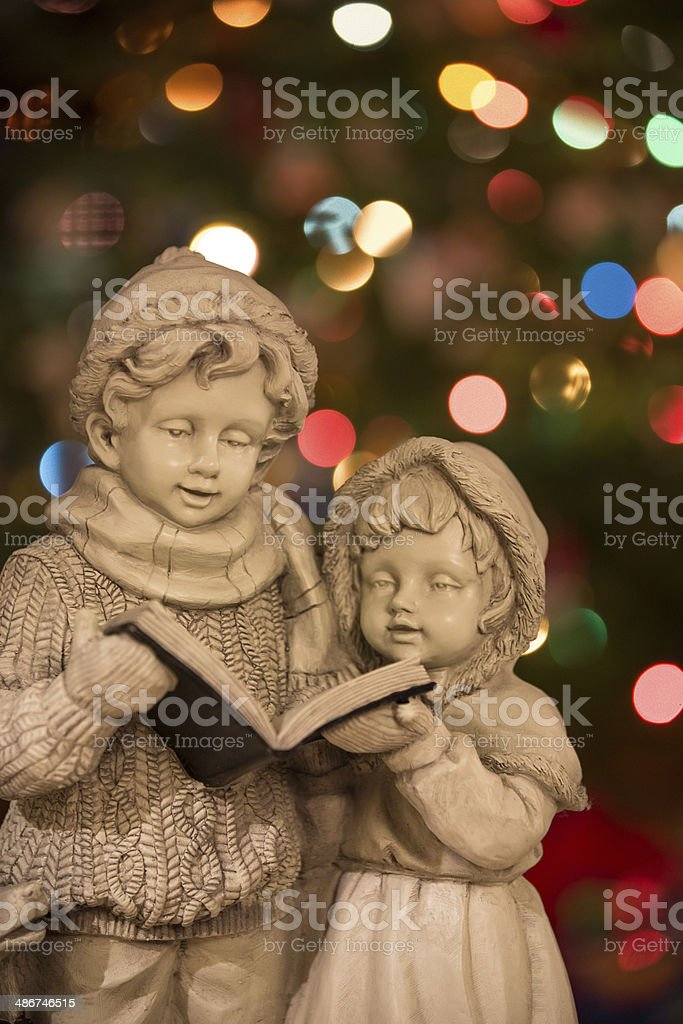 Christmas Carolers with Christmas Lights - Vertical stock photo