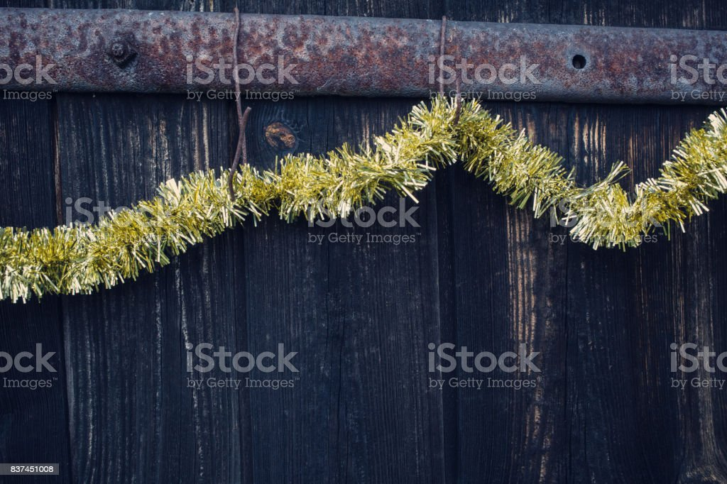 Christmas chain hanging on the old wooden door. stock photo