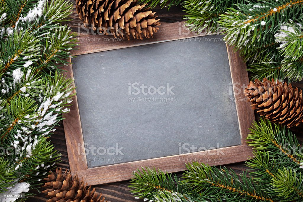 Christmas chalkboard and fir tree stock photo