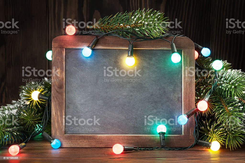 Christmas chalkboard, tree and lights stock photo