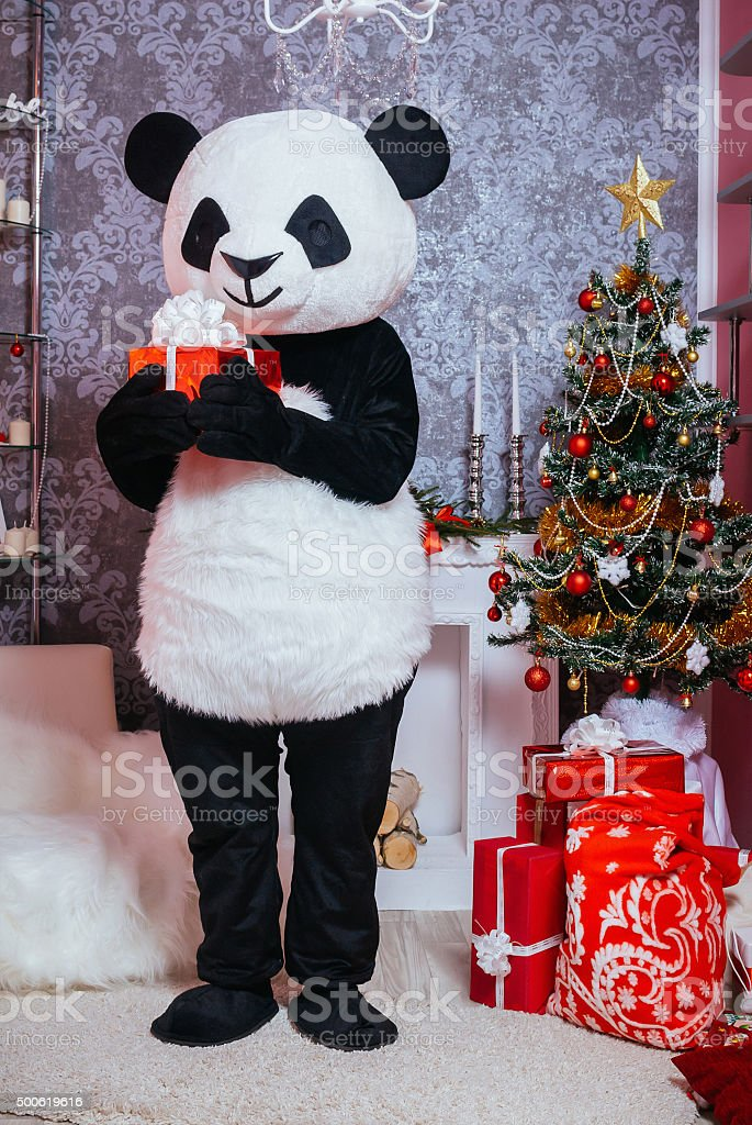 Christmas character holding a gift stock photo