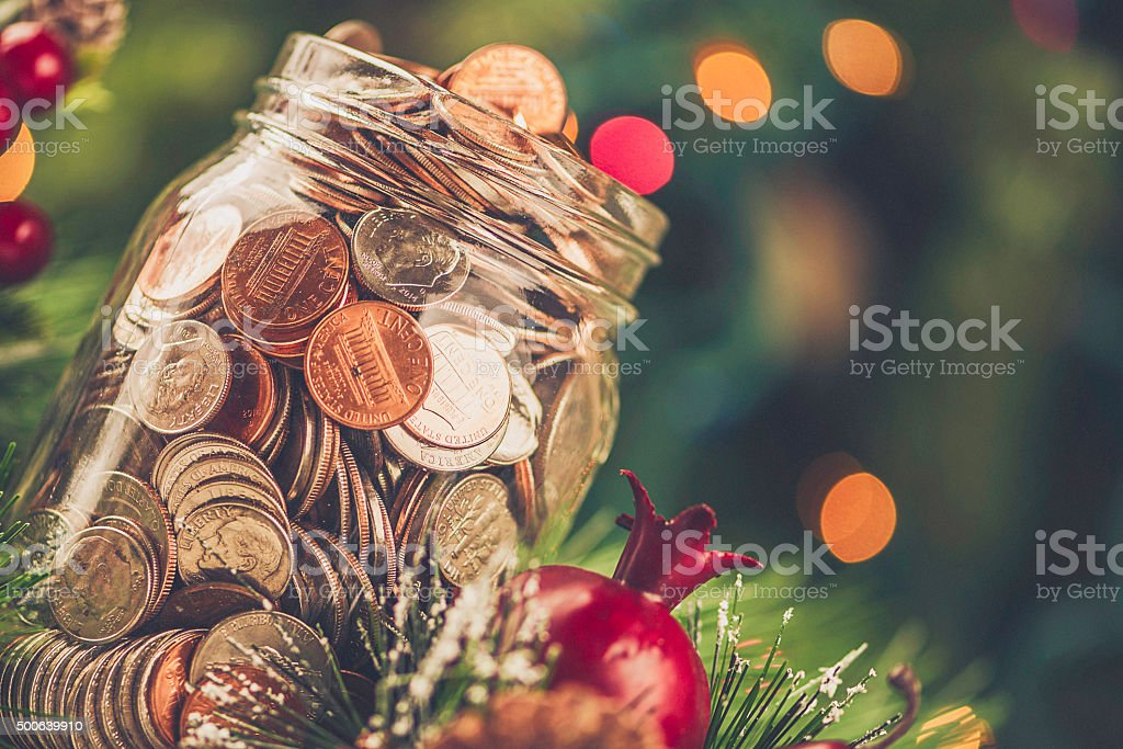 Christmas charity donation jar filled with American currency stock photo