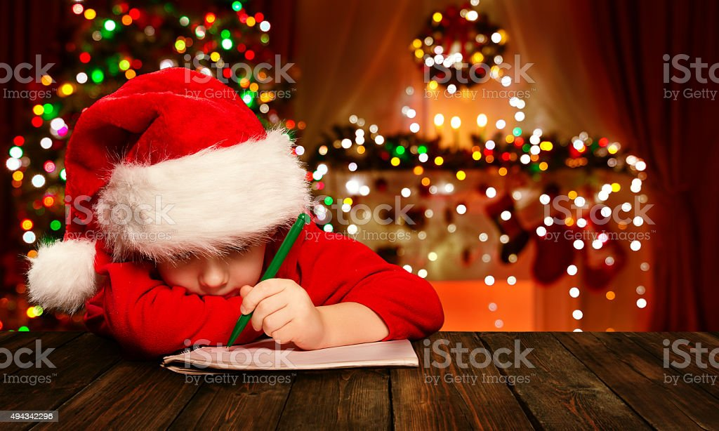 Christmas Child Write Letter Santa Claus, Kid Santa Hat Writing stock photo