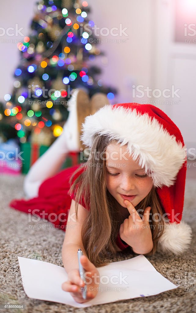 Christmas Child Writing a Letter to Santa Claus stock photo