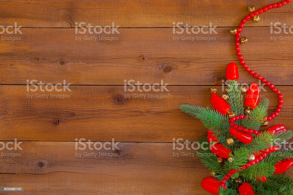 Christmas Chili Peppers and evergreen branches on wood (P) stock photo