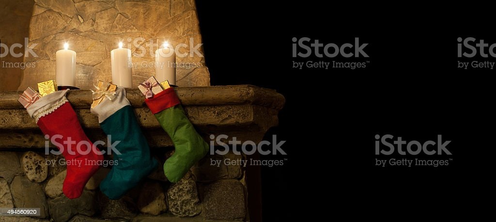 christmas chimney place interiot. stockings on fireplace background stock photo