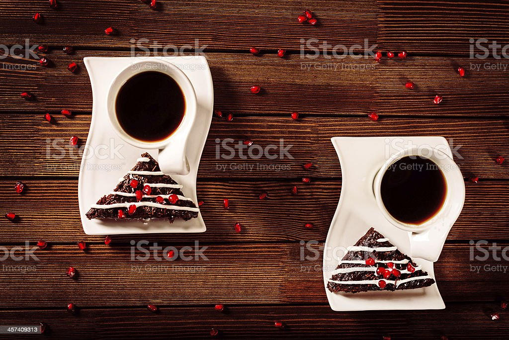 Christmas chocolate cake dessert with pomegranate and coffee royalty-free stock photo