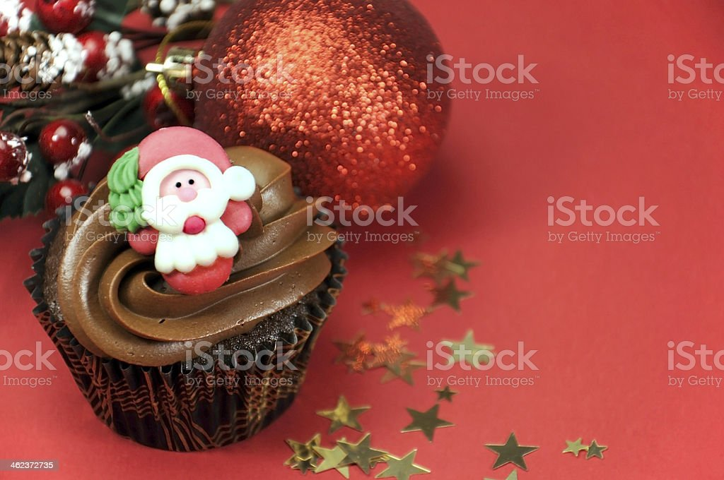 Christmas chocolate cupcakes with Santa faces stock photo