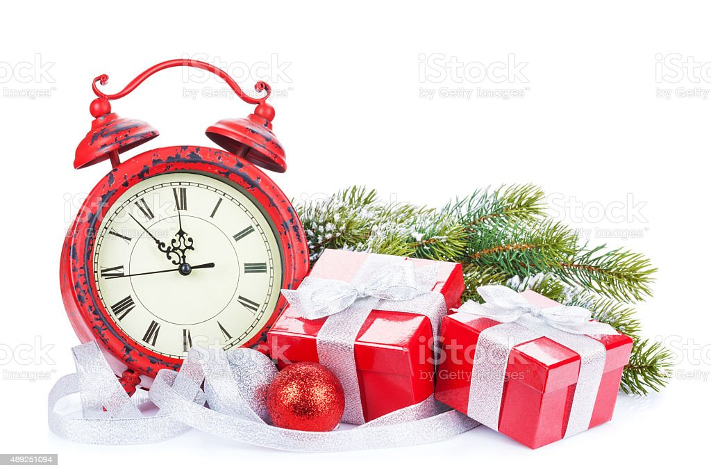 Christmas clock, gift boxes and snow fir tree stock photo
