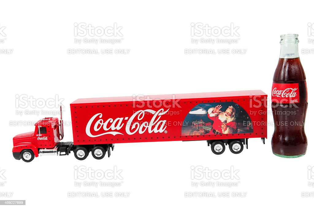Christmas Coca Cola truck and a bottle royalty-free stock photo