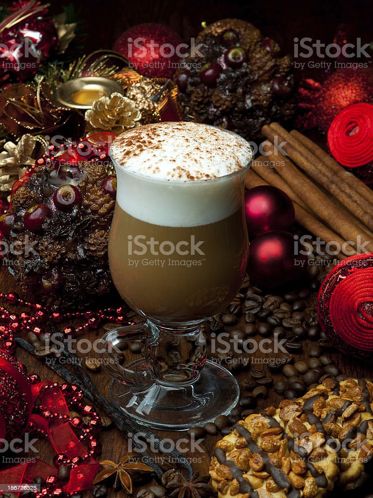 Christmas coffee with foam and spices with decorations royalty-free stock photo