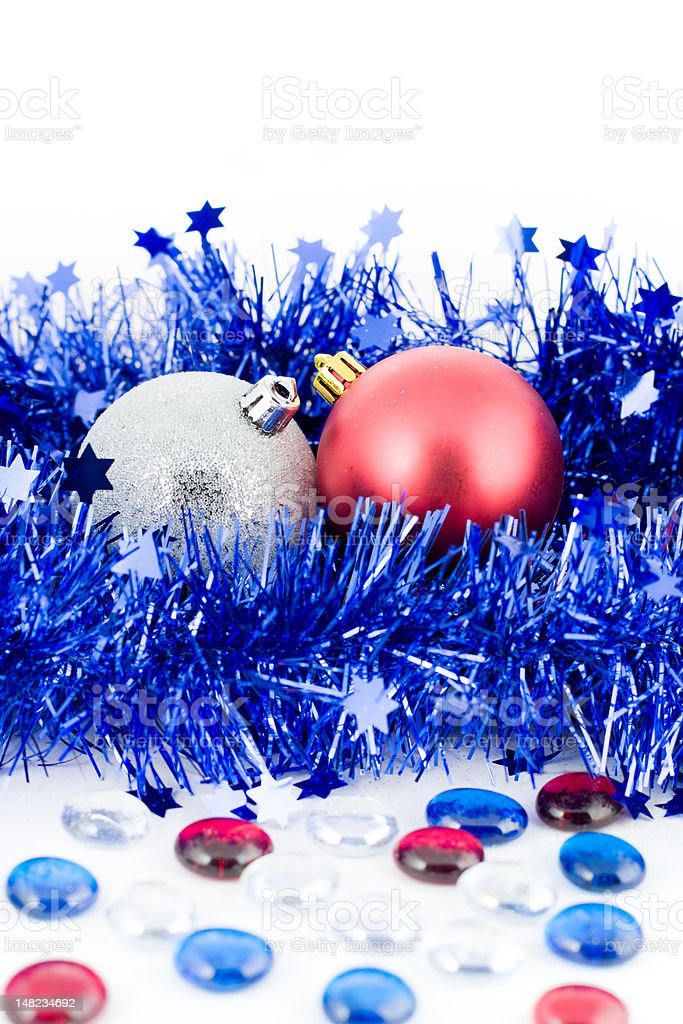 christmas colored balls in blue tinsel with marbles vertical orientation royalty-free stock photo