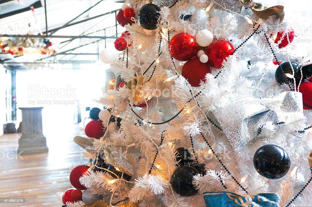 Christmas colorful balls on a white Christmas tree stock photo