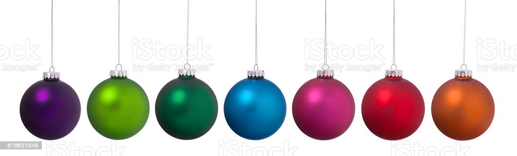 Christmas Colorful Baubles Ornaments Hanging in a Row on White stock photo