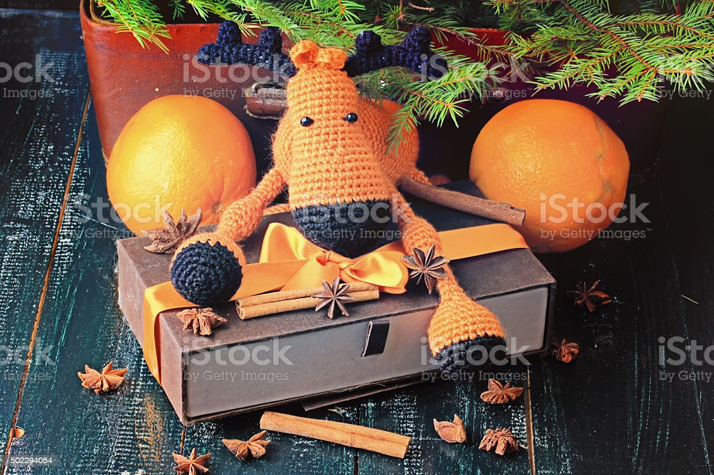 Christmas composition deer gift under the tree stock photo
