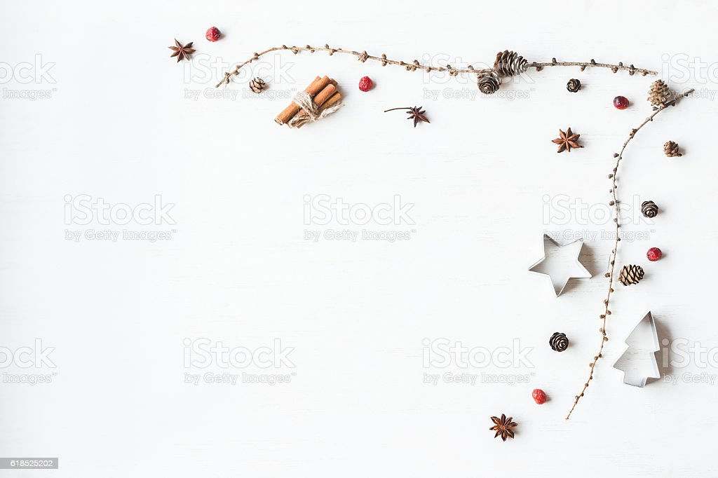 Christmas composition. Larch branches, cinnamon sticks, anise star, dried cranberry stock photo