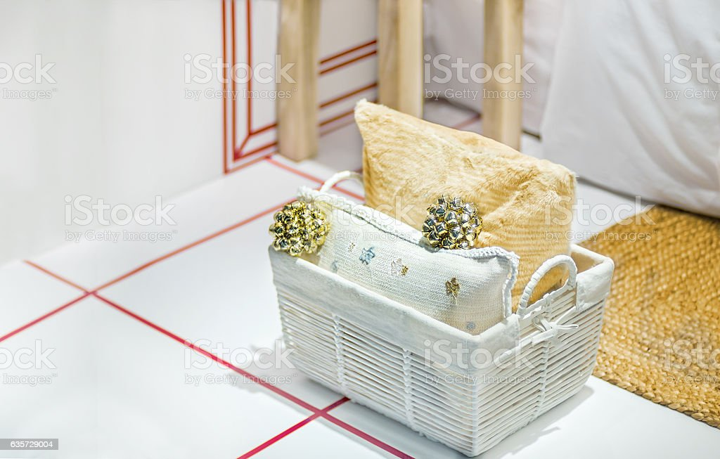 Christmas composition of basket with two pillows and christmas toys stock photo
