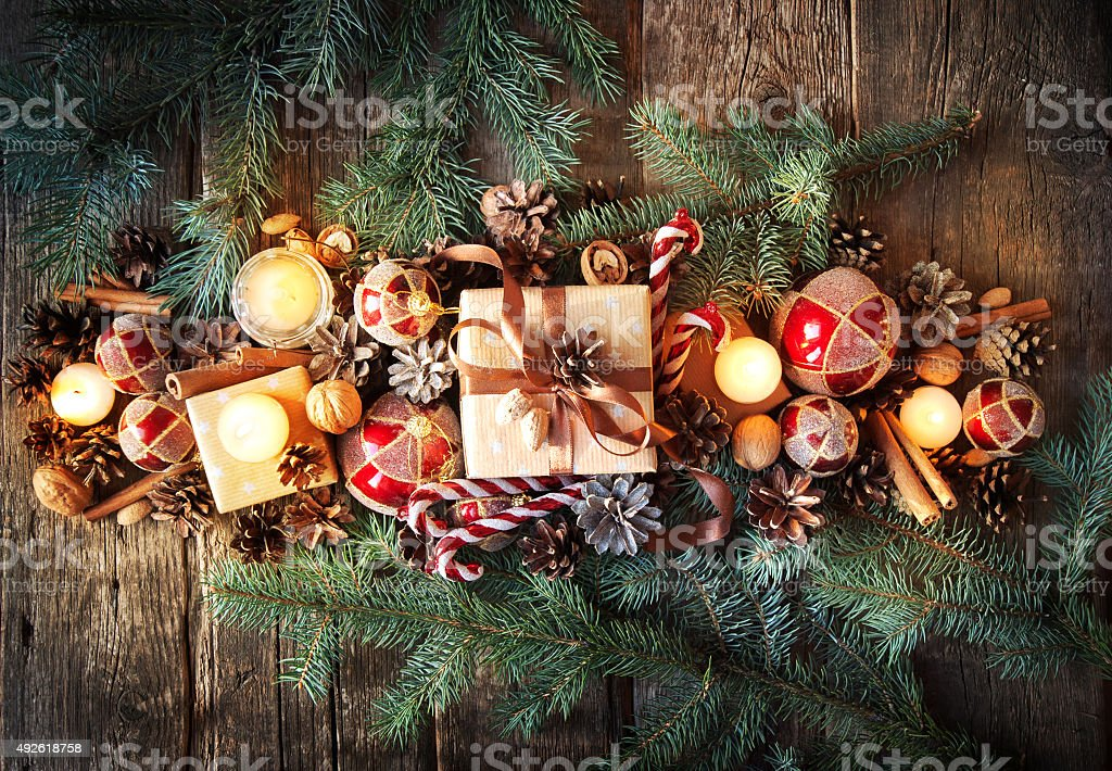 Christmas Composition Top View. Fir Tree Toys, Candles and Spruce stock photo
