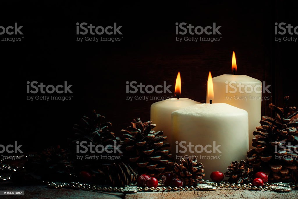 Christmas composition with burning white candles, stock photo