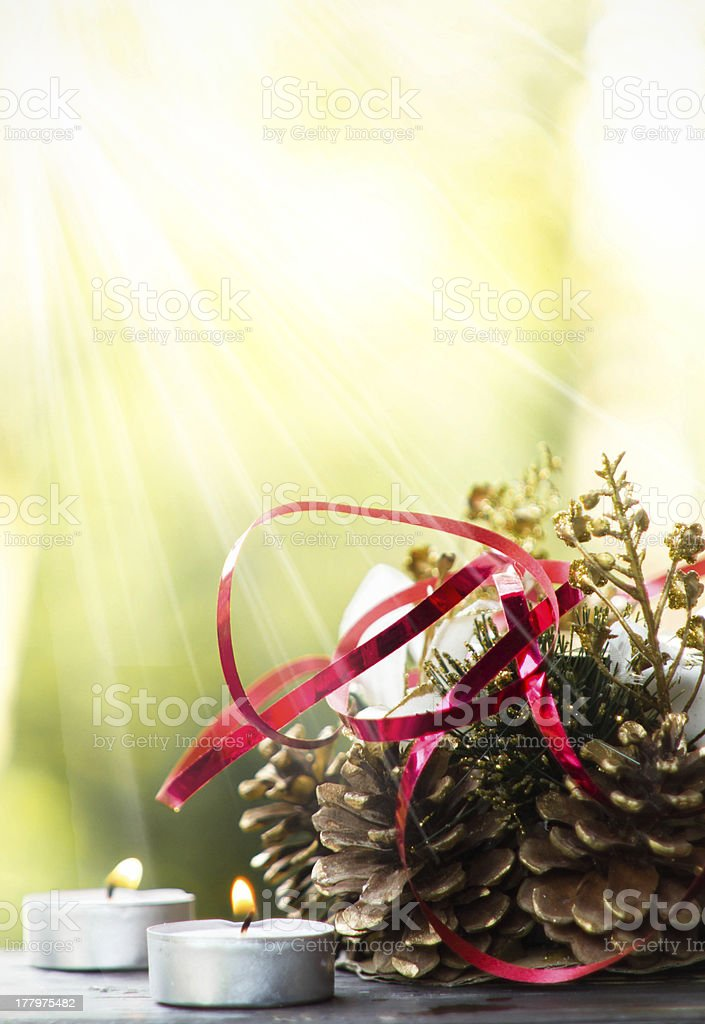 Christmas composition with candles and decorations royalty-free stock photo