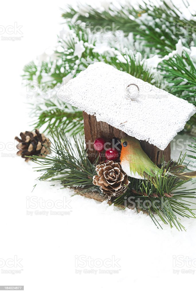 Christmas composition with fir branches and birdhouse, isolated royalty-free stock photo