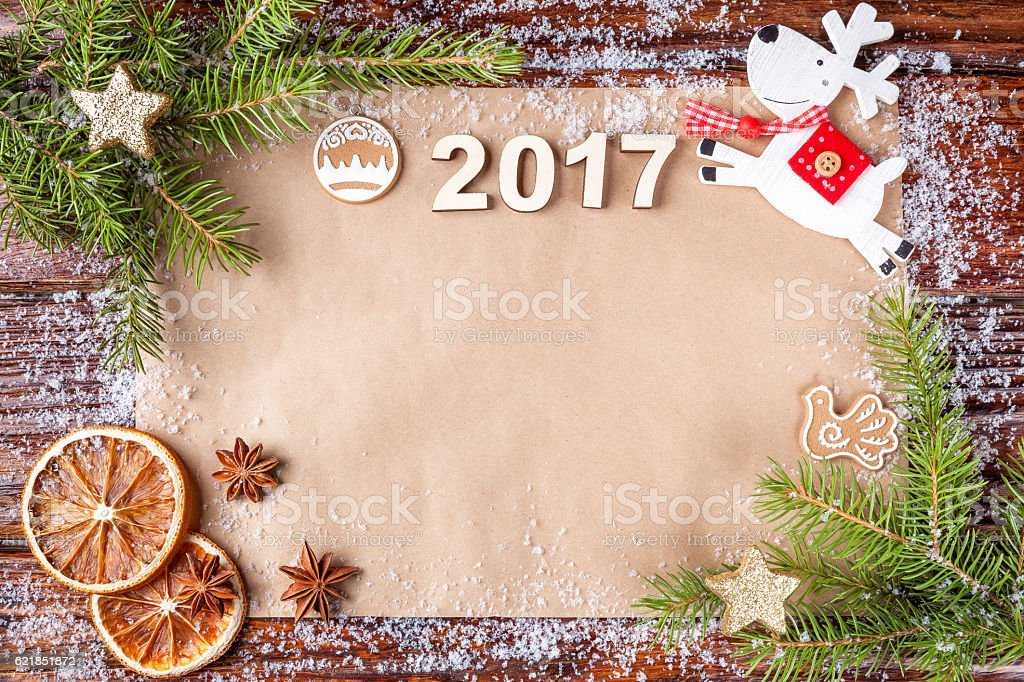 Christmas composition with number of year 2017 on vintage paper stock photo